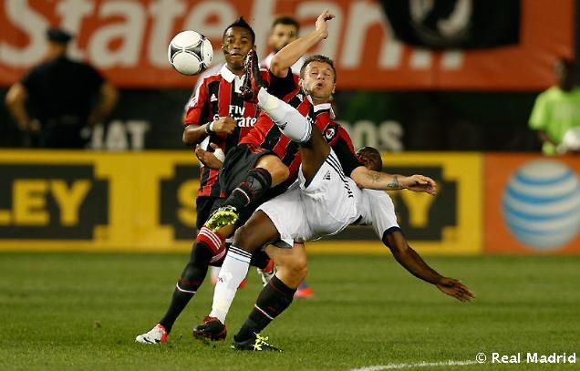 http://s1.picofile.com/file/7463988595/Real_Madrid_Milan34.jpg